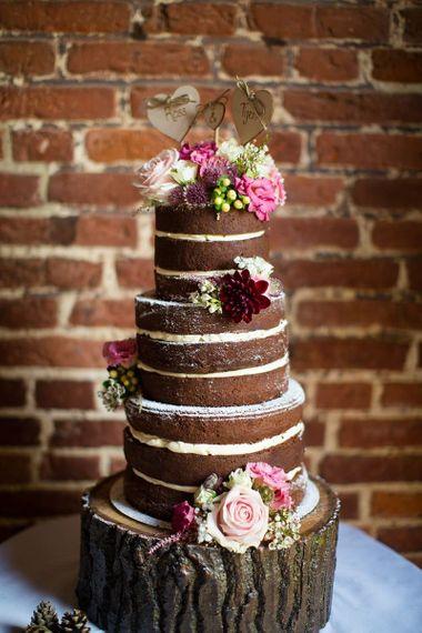 Naked chocolate wedding cake on tree stump