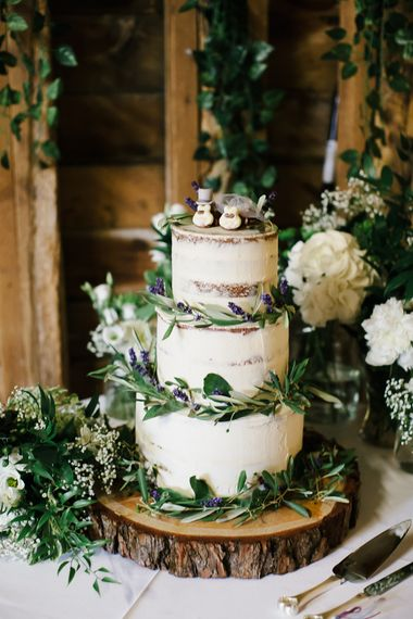 semi naked rustic wedding cake decorated with foliage - rustic wedding cakes