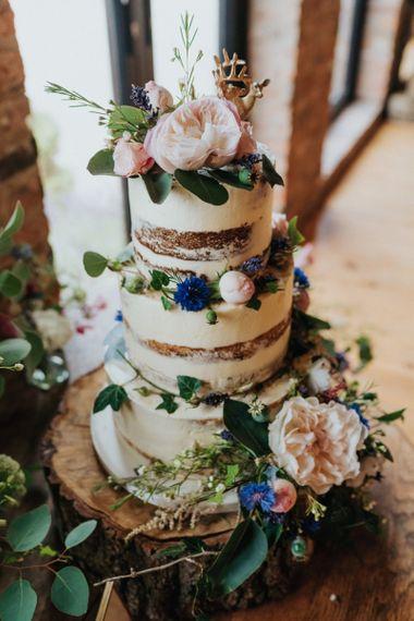 Semi naked wedding cake on tree stump