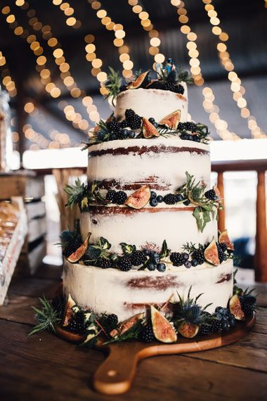 Semi naked rustic wedding cake decorated with blackberries and figs - rustic wedding cakes