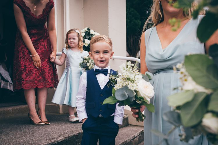 Page Boy in Navy Suit and Bow Tie | Bridesmaid in Mint Green Maids to Measure Dress with Cowl Neck | Flower Girl in Satin Mint Green Dress | Nautical Wedding on SS Nomadic Boat in Belfast with Black Tie Dress Code | Sarah Gray Photography