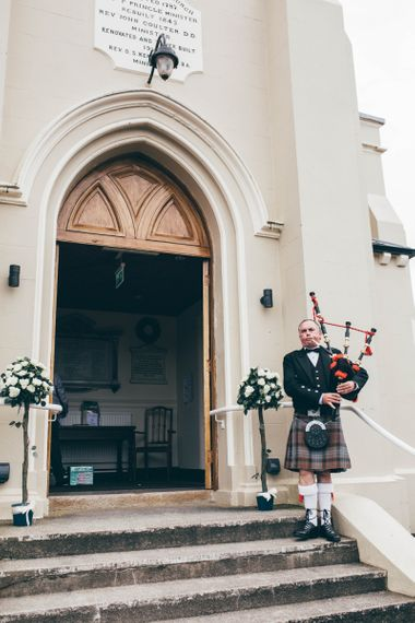 Father of the Bride in Traditional Kilt Playing Bagpipes | Wedding Ceremony at Gilnahirk Presbyterian Church | Nautical Wedding on SS Nomadic Boat in Belfast with Black Tie Dress Code | Sarah Gray Photography