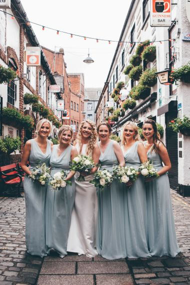 Bride in Satin Jesus Peiro Dress with V-Neck and Waist Bow with Beaded Belt | Floor Length Double Tier Veil with Blusher | Bridesmaids in Mint Green Maids to Measure Dresses with Cowl Neck | Wedding Bouquets of White Flowers and Foliage |  | Nautical Wedding on SS Nomadic Boat in Belfast with Black Tie Dress Code | Sarah Gray Photography