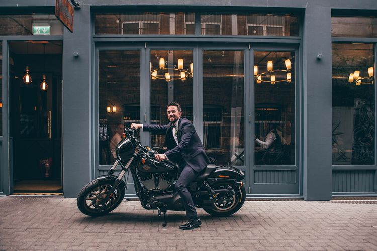 Groom in Black Tie Suit from Moss Bros. with Bow Tie | Motorbike Outside The Muddlers Club, Belfast | Nautical Wedding on SS Nomadic Boat in Belfast with Black Tie Dress Code | Sarah Gray Photography