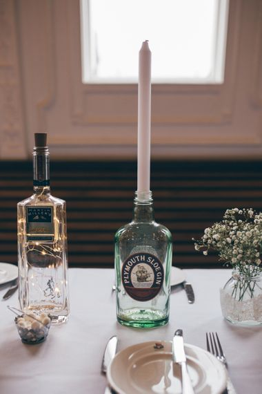 Gin Bottle Décor | Pink Tapered Candle | Gypsophila in Bud Vase with Lace Ribbon | Nautical Wedding on SS Nomadic Boat in Belfast with Black Tie Dress Code | Sarah Gray Photography