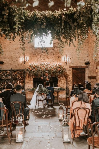 Cripps barn intimate wedding ceremony with foliage wedding decor
