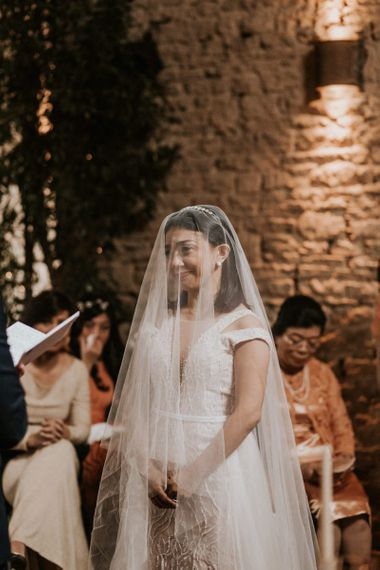 Bride with veil on during the wedding ceremony