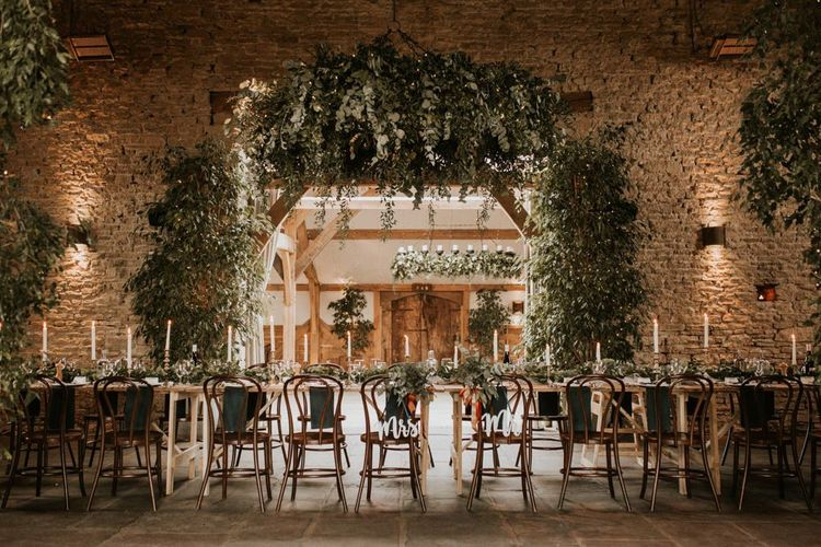 Intimate wedding reception at Cripps Barn with foliage wedding decor