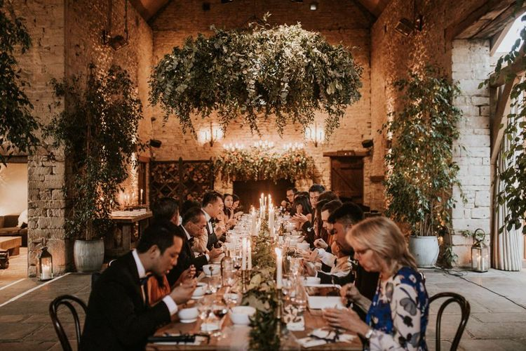 Intimate wedding breakfast at Cripps Barn with candle light centrepieces