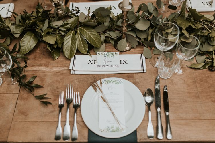 Place setting with foliage table runner and menu card