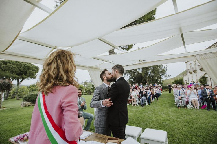 Groom and groom kiss
