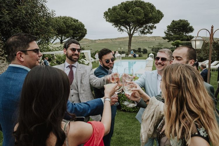 Wedding guests toast the day