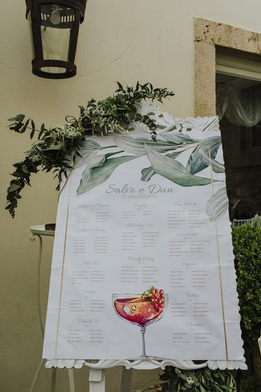 Wedding table seating plan with olive branch decor