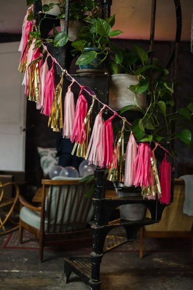 Pink and gold hanging tassel decor at casual and relaxed wedding ceremony in London