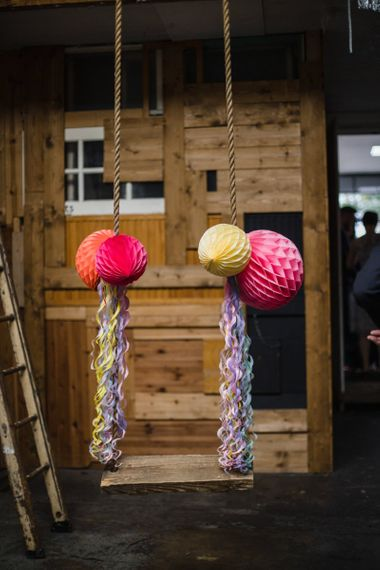 Brightly coloured paper lanterns at industrial wedding ceremony