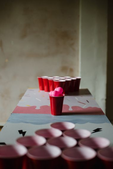 Beer pong game at casual wedding reception with industrial