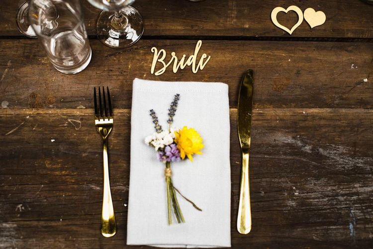 Brides industrial table setting with delicate floral decor tied with string