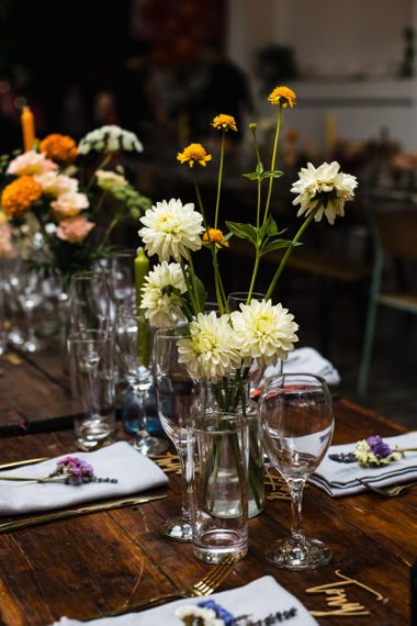 Industrial wedding reception in London with lots of bright floral decor