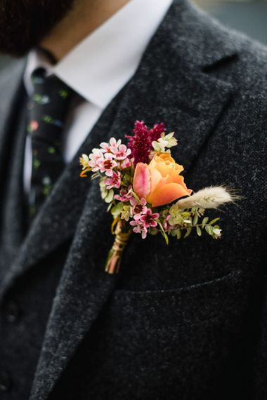 Pink and orange floral buttonhole arrangement at casual wedding in London