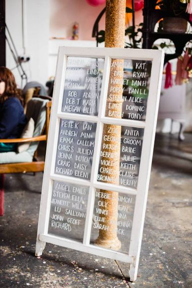 Glass window table plan with white details for industrial wedding in London