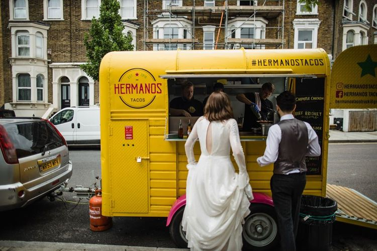 Bride in glasses and groom at London wedding with taco truck