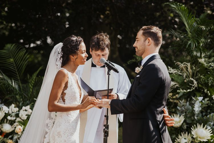 Bride and groom exchanging vows at Babington House wedding venue