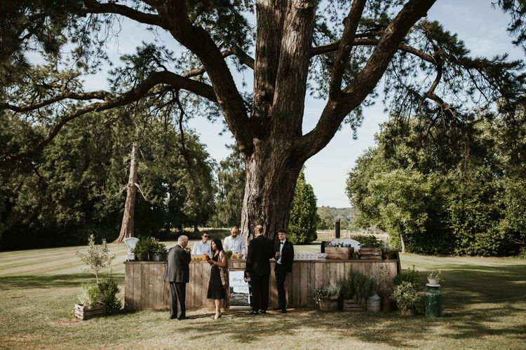 户外rustic bar at Babington House wedding venue