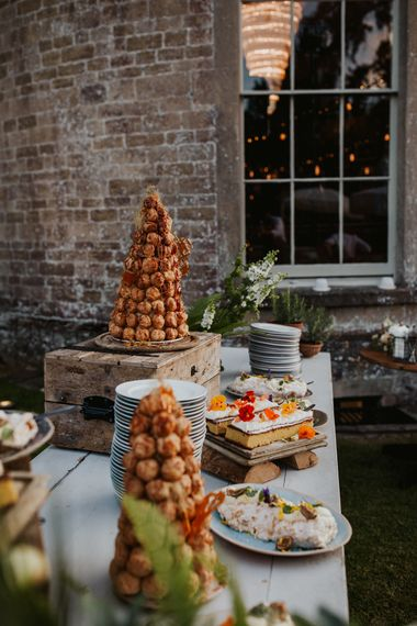 Dessert table with croquembouche tower