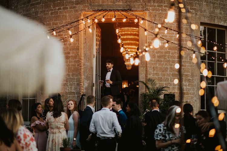 Festoon light covered courtyard at Babington House wedding venue