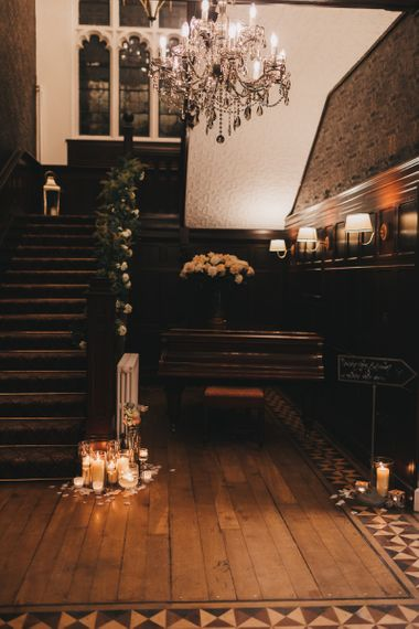 North Wales wedding venue Tyn Dwr Hall Stairs Decorated with Candles and Floral Hand Rail Decor