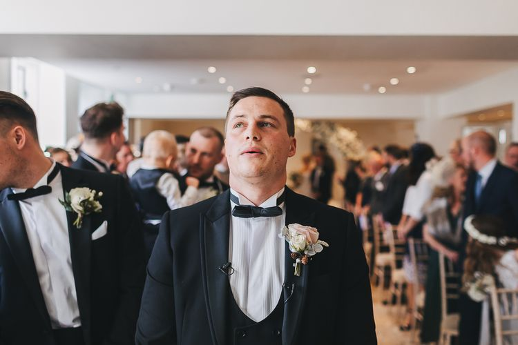 Emotional Groom at the Altar in Black Tuxedo and Bow Tie