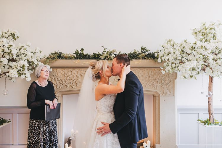 Wedding Ceremony with Bride in Pronovias 'Edith' Wedding Dress Kissing Groom in Black Tie at the Altar