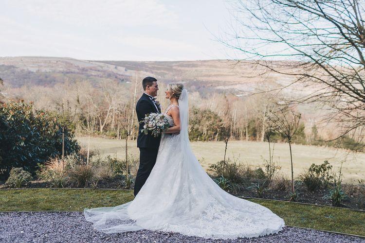 Bride in Pronovias 'Edith' Wedding Dress and Groom in Moss Bros. Tuxedo