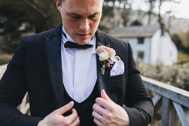 Groom in Tuxedo, Bow Tie and Rose Buttonhole