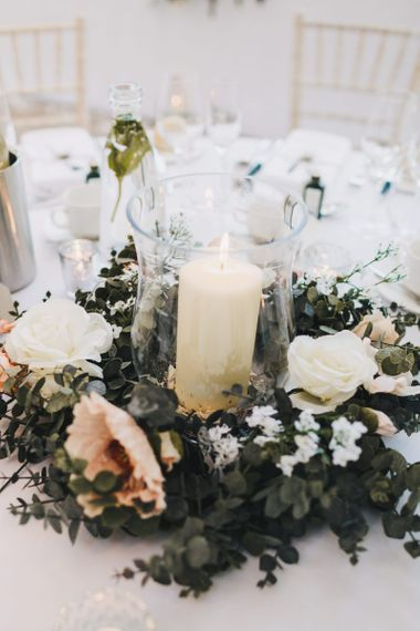 Centrepiece with Giant Candle and Floral Surround