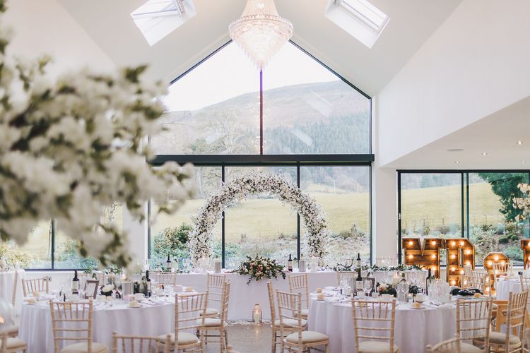 Reception at North Wales wedding venue Tyn Dwr Hall with White Floral Arch