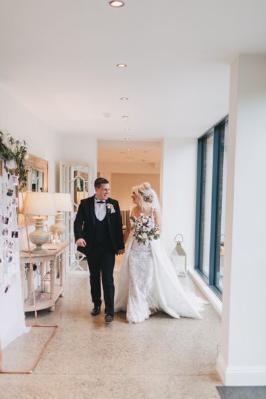 Bride in Pronovias Edith Wedding Dress and Groom in Black Tuxedo