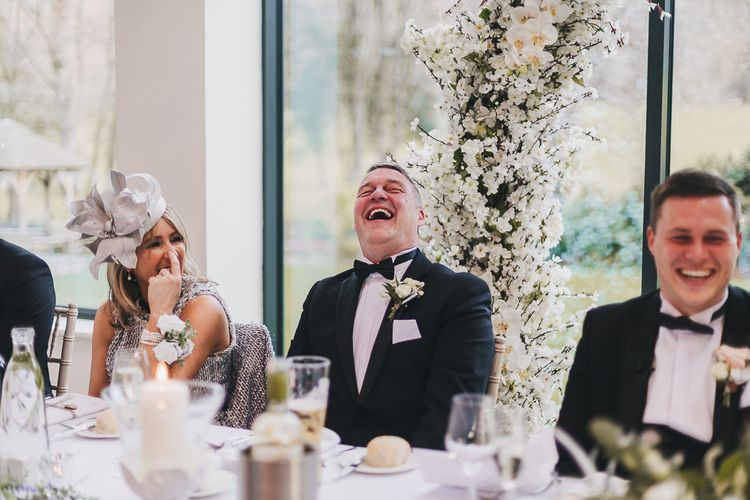 Mother and Father of The Groom Laughing During Wedding Speeches