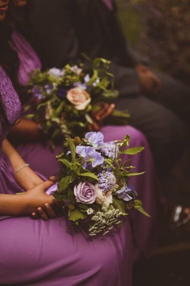 Bridesmaid poset with purple flowers and foliage