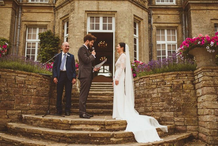Bride and groom exchanging vows at Hedsor House wedding ceremony
