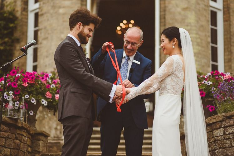 Hand fastening ceremony at Hedsor House wedding