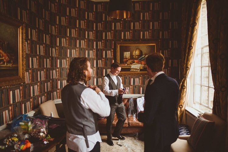 Groom getting ready on wedding morning at Hedsor House
