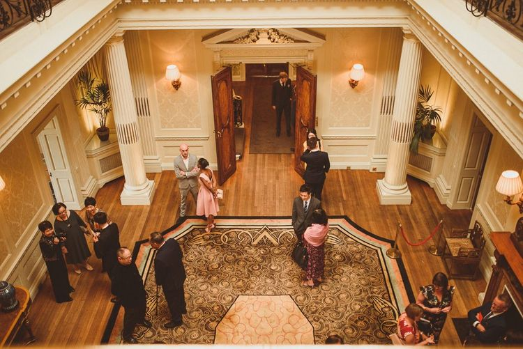 Wedding guests congregating at the lobby at Hedsor House