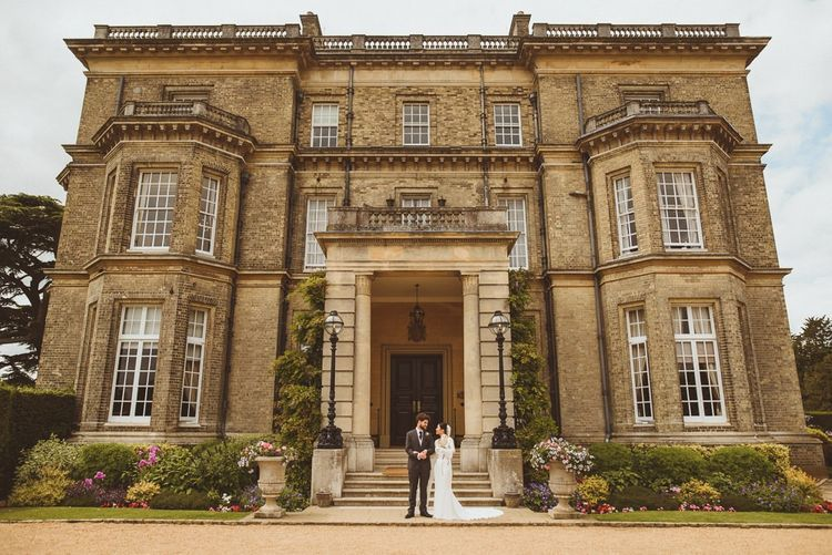 Bride and groom portrait in front of Hedsor House wedding venue