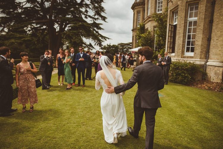 Outdoor drinks reception at country house wedding venue