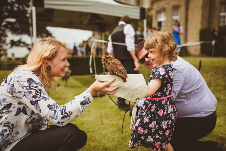 Wedding guests holding Falconry brides