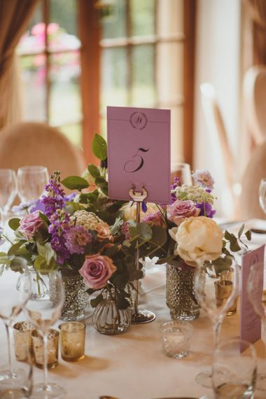 Low wedding flower centrepiece and table name