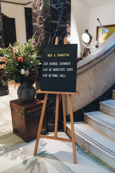 Black and white peg board wedding sign at Town Hall Hotel wedding ceremony
