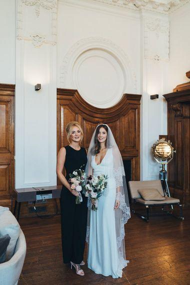 Bride and bridesmaids in elegant black bridesmaid dresses