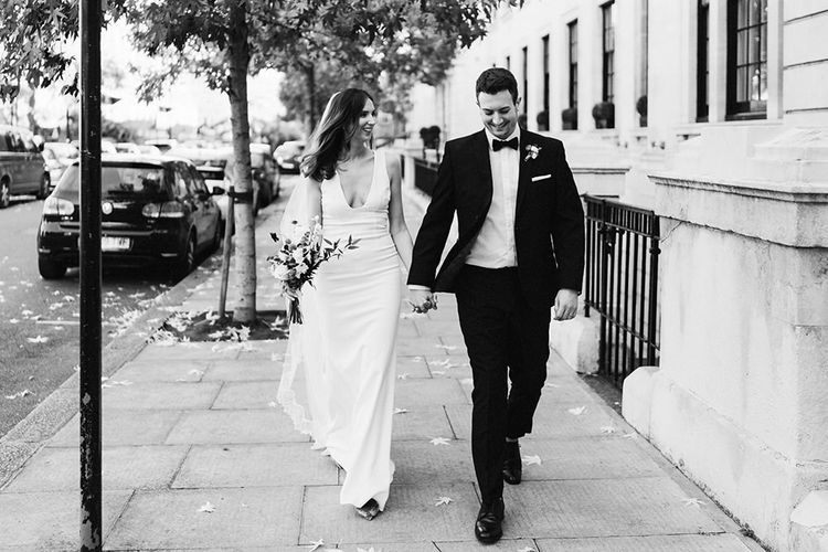 Bride and Groom steal a moment walking around East London